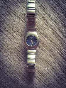 **ROOTS STAINLESS STEEL LADIES WATCH FOR SALE**