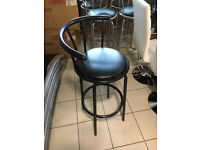 Swivel bar stools with leather padded seat
