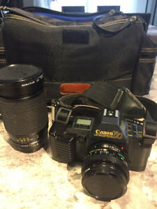 Canon T70 35 mm reflex camera + case