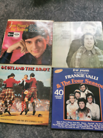 Selection of 24 vinyl records