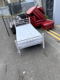 13. Metal bed frame and mattress