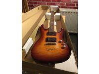 Vintage electric guitar in sunburst colour.