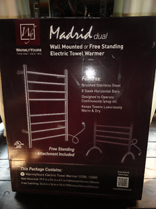 Wall mounted or free standing electric towel warmer.