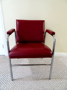 Red shampoo chair with tilting back