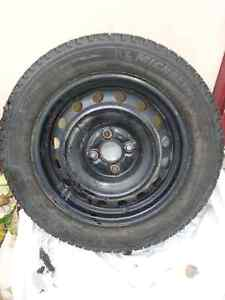 For sale: 4 MICHELIN X-ICE WINTER TIRES (on rims)  P185/60R15