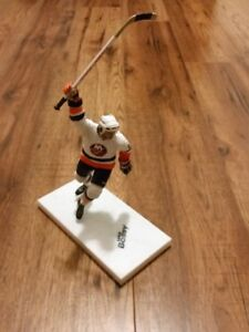 NHL figurines , Mike Bossy, Phil Esposito, Grant Fuhr and more