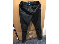 Women black trousers with little shiny flowers Size 170/M