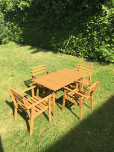 IKEA FALHOLMEN outdoor table and 4 armchairs .