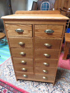 a HAND MADE 12 DRAWER OAK CABINET IN GREAT CONDITION