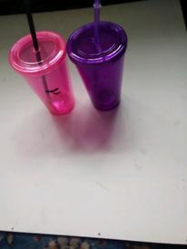 2 Halloween beakers with straws