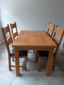 Solid oak dining table extendable matching chairs