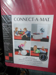 Connect-A-Mat brand new in shrink wrap 4 foam tiles red/black