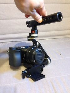 DSLR video cage adjustable universal with rosettes and rods West Island Greater Montréal image 3