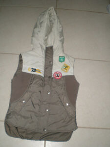 New Vest Size Small; 15 inches in shoulders.