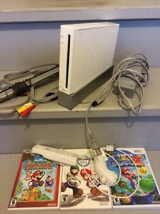 Wii system with 1 controller, 1 nunchuck & 3 games for $120