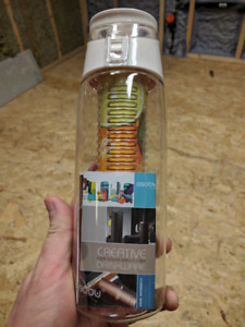 Water bottle with built in fruit infuser