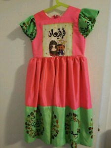 Pink and green dress .