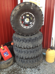 38.5x13.5 r16 military XML tires on aluminum 8 bolt 10 wide rim