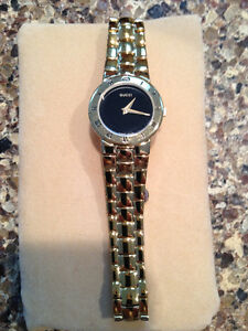 7720eb63e3d Authentic Gucci Gold Plated Black Dial Ladies Watch