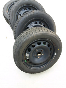 VW JETTA RIMS WITH 205/55/16 WINTER TIRES