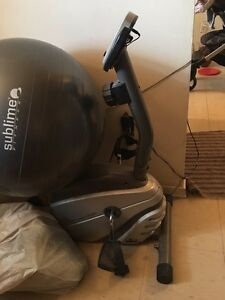 Exercise bike with yoga ball