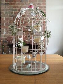Decorative candlelit birdcages