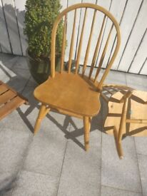 Two rubber wood stick back chairs £35