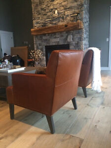 2 leather cognac chairs