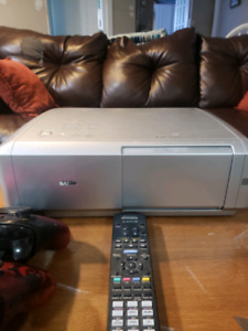Sanyo PLV Z5 home theater projector and screen