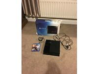 PS4 with 2 games and 2 pads