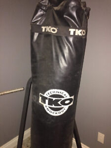 TKO punching bag and stand comes with a pair of gloves.