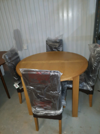 A new good quality round extending dining table x 4 chairs.