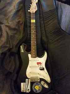 Fender Electric guitar with case and strap
