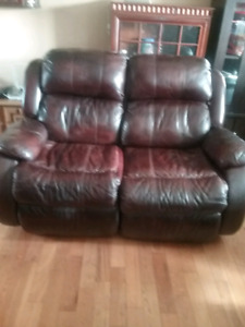 Leather love seat recliner.