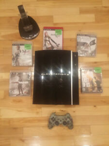 PLAYSTATION 3 WITH GAMES AND CONSOLE  (WORKS GREAT)