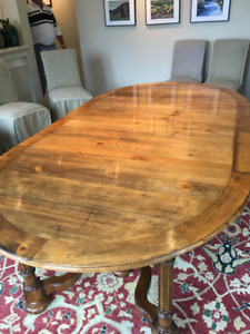 Oval Oak Dining Table and Ten Chairs