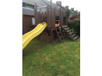 FORT WITH SLIDE. VERY ROBUST. NOW FOR SALE DUE TO MOVING TO SMALLER GARDEN.