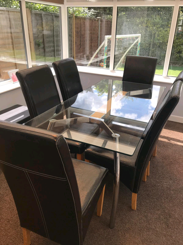 Glass dining table with chrome legs for sale, and 6 x ...
