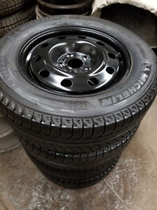 205 55 16 Michelin XIce3 tires on OEM VW Golf Jetta rims 5 x 112
