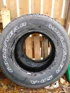 1 Good Year  truck tire and Chevy tail lights $ 40 for all.