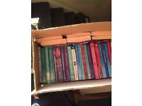 Box of at least 25 Mills and Boon type books