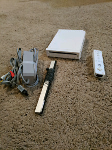 Nintendo Wii with cables and one controller