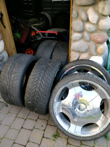 Brand new tires with 22 inch chrome rims + two spare