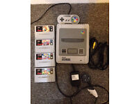 Super Nintendo with games all official leads & controller