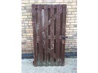 Wooden slatted gate