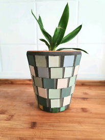 Hand decorated plant pot with green mosaic and grey grout