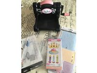 Sizzix big shot die cutting machine with embossing folders and dies