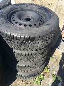 235/60 R16, 4 GOODYEAR NORDIC winter tires with rims thread 9/32