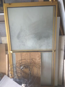 shower doors / mirror with gold frames