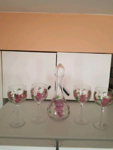 Wine glasses with serving bottle